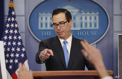 Treasury Secretary Steve Mnuchin gestures as he answers questions during a press briefing at the White House in Washington,  Feb. 23, 2018.