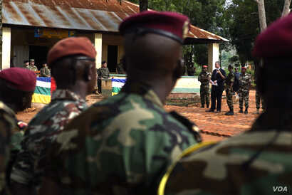 U.S. Ambassador to Central African Republic Jeffrey Hawkins delivers a speech to about 100 members of the C.A.R. army during a ceremony to turn over non-lethal aid. (Z. Baddorf/VOA)