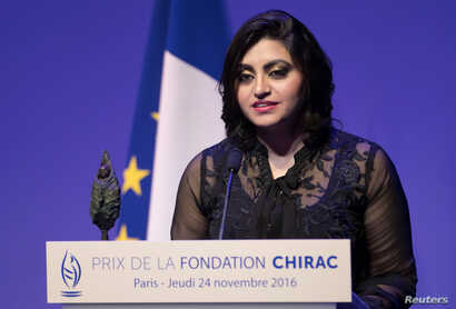 """FILE - Pakistan's Gulalai Ismail delivers an acceptance speech after being awarded the Prize for Conflict Prevention for the work of her organization """"Aware Girls"""" promoting women's issues and equality in Pakistan, during the award ceremony of the Ja..."""