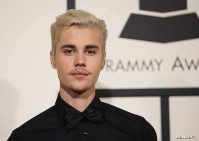 Singer Justin Bieber arrives at the 58th Grammy Awards in Los Angeles, California, Feb. 15, 2016.