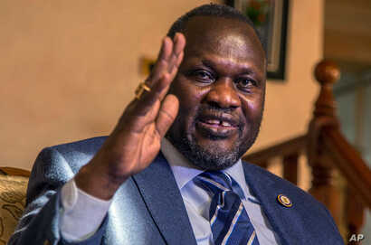 FILE — South Sudan rebel leader Riek Machar talks to reporters in Addis Ababa, Ethiopia, Feb. 13, 2016. Machar fled from Juba last month shortly after heavy fighting broke out in the capital between Machar's forces and South Sudan army forces.