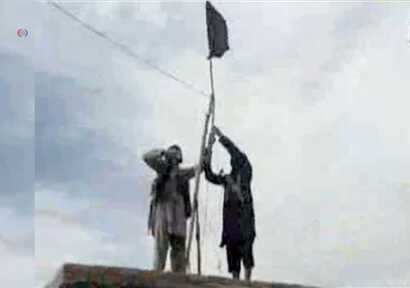 FILE - Members of Islamic State-Khorasan raise a flag in a tribal region of Afghanistan, Nov. 2, 2015.