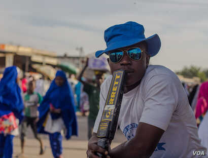 Mohammed, one of the youth vigilantes as part of the Borno Youth Empowerment Scheme, at his post in Monday Market, Maiduguri. (Fati Abubakar)