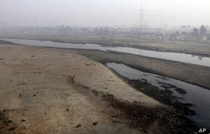 Very little water flows in the Ravi River in Lahore, Pakistan, Dec. 14, 2016. Under the Indus Water Treaty, India has exclusive rights to three Indus basin rivers,