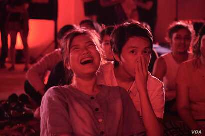 "Women laugh at a Burmese language performance of ""The Vagina Monologues' in Yangon, Myanmar."