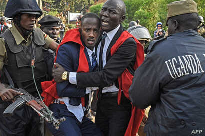 Students of Makerere University clash with police officers during a protest against the official procedure to scrap a presidential age limit from the constitution in Kampala on Sept. 21, 2017.