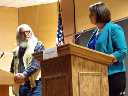 FILE - In this Oct. 5, 2016, photo, Libertarian Party candidate Rick Breckenridge, left, looks on during a debate with Democratic U.S. House candidate Denise Juneau in Great Falls, Mont. Breckenridge, who is running for U.S. Senate this year, endorse...