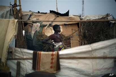 Christian refugees create a home for themselves in makeshift shelters near the airport in Bangui, Central African Republic, Tuesday Jan. 28, 2014, as they try to escape from the deepening divisions between the country's Muslim minority and Christian ...
