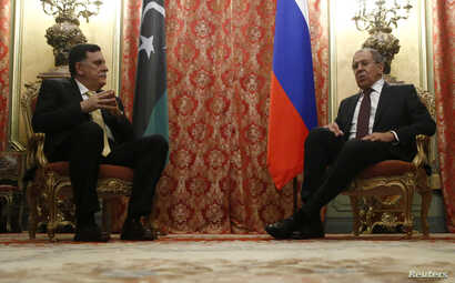 Russian Foreign Minister Sergei Lavrov (R) meets with Libyan Prime Minister Fayez Seraj in Moscow, Russia, March 2, 2017.