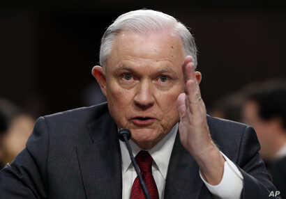 Attorney General Jeff Sessions testifies before the Senate Intelligence Committee hearing about his role in the firing of James Comey, his Russian contacts during the campaign and his decision to recuse from an investigation into possible ties betwee