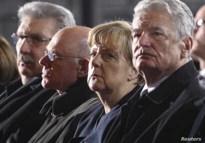 (R-L) German President Joachim Gauck, Chancellor Angela Merkel and Norbert Lammert, President of Germany's lower house of parliament Bundestag attend a service at Berlin's Memorial church (Gedaechtniskirche) to commemorate the 12 killed victims of a ...
