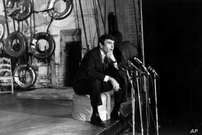 """FILE - Playwright Edward Albee, winner of the 1967 Pulitzer Prize for drama, talks to reporters during a news conference at the Cherry Lane Theater in Greenwich Village in New York City, May 2, 1967. Albee won for his play """"A Delicate Balance."""""""