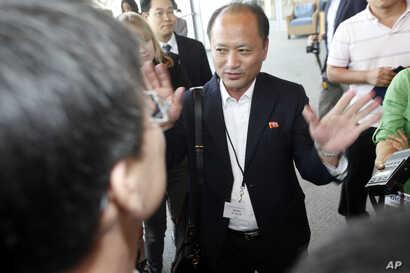 FILE - North Korean official Song Il Hyok refuses to answer questions from members of the media when he arrived to attend but not participate in a news conference following the Institute on Global Conflict and Cooperation conference on the campus of ...