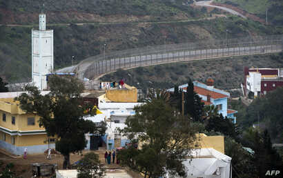 A picture shows a general view of the fence between the Moroccan city of Fnideq and the tiny Spanish enclave of Ceuta, Feb. 17, 2017.