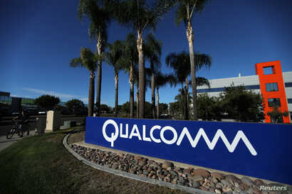 A sign on the Qualcomm campus is seen in San Diego, California, Nov. 6, 2017.
