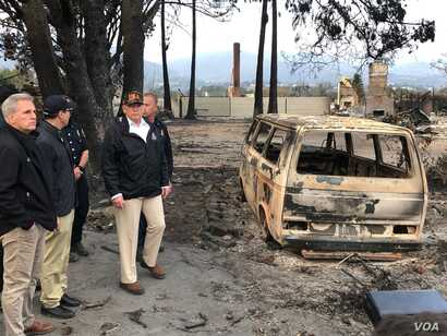 President Donald Trump surveys the damage done by the Woolsey Fire in Malibu, Calif., Nov. 17, 2018. At left is Congressman Kevin McCarthy, who represents a nearby district.