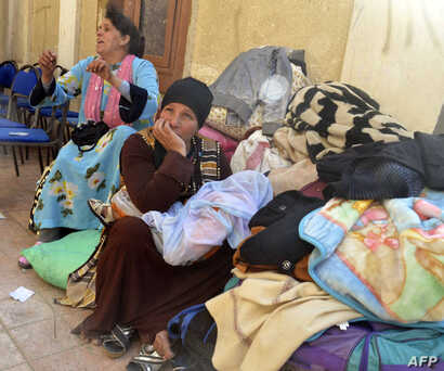 Egyptian Coptic Christians sit in the courtyard of the Evangelical Church in the Suez Canal city of Ismailia, Feb. 24, 2017, upon arriving to take refuge from Islamic State jihadists.