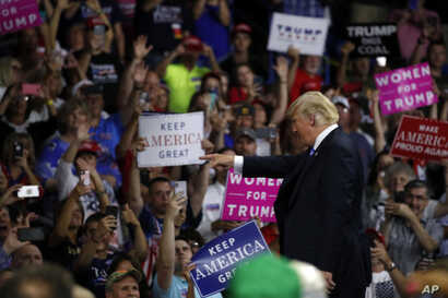President Donald Trump points to a supporter after speaking during a rally, Aug. 21, 2018, in Charleston, West Virginia.