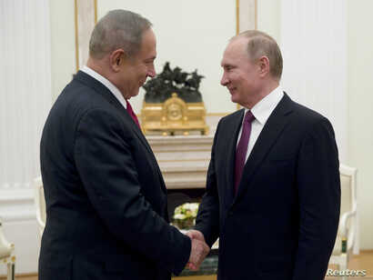 Russian President Vladimir Putin, right, shakes hands with Israeli Prime Minister Benjamin Netanyahu during a meeting in Moscow, March 9, 2017.