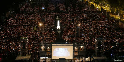 Thousands of people take part in a candlelight vigil to mark the 29th anniversary of the crackdown of pro-democracy movement at Beijing's Tiananmen Square in 1989, at Victoria Park in Hong Kong, China June 4, 2018.