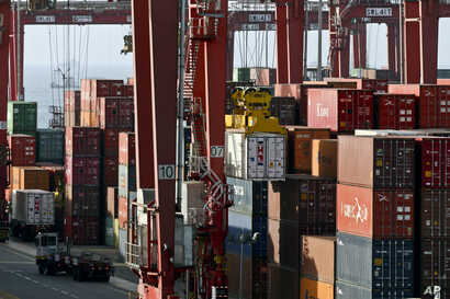 Containers are stacked in the port of El Callao, Peru, Nov. 17, 2016. Asia-Pacific Economic Cooperation leaders will meet in Lima Nov. 19-20 to discuss the future of international trade policies, growth and improvement of life conditions for more tha...