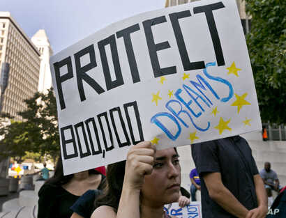 An unidentified student joins a rally in support of the Deferred Action for Childhood Arrivals, or DACA program, outside the Edward Roybal Federal Building in downtown Los Angeles, Sept. 1, 2017.