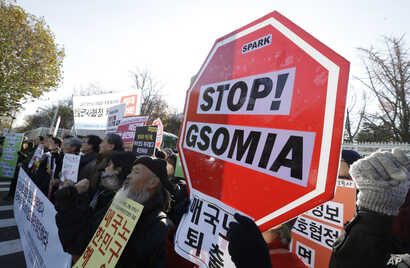South Korean protesters stage a rally to oppose the General Security of Military Information Agreement between South Korea and Japan, in front of the Defense Ministry in Seoul, Nov. 23, 2016. The intelligence-sharing agreement is designed to better d...