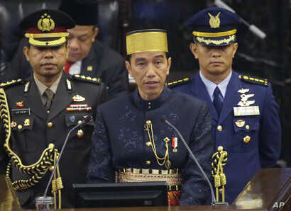 Indonesia's President Joko Widodo, center, delivers his State of The Nation address ahead of the country's Independence Day at the parliament building in Jakarta, Indonesia, Aug. 16, 2017.