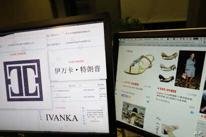 FILE - In this April 21, 2017, file photo, images of trademark applications from Ivanka Trump Marks LLC, taken off the website of China's trademark database, are displayed next to a Chinese online shopping website selling purported Ivanka Trump brand...