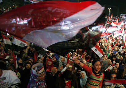 FILE - Supporters of Egypt's army and police gather at Tahrir square in Cairo, on the third anniversary of Egypt's uprising, Jan. 25, 2014. The government, wary of new protests, has tightened security in Cairo.