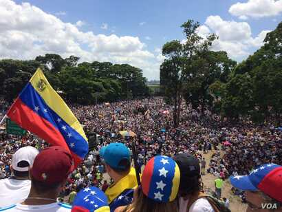 Opponents of President Nicolas Maduro wave a Venezuelan national flag as thousands gather in Caracas, Venezuela,  May 20, 2017. Tens of thousands of demonstrators took to the streets again in what has been two months of near-daily street protests.