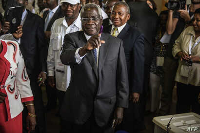 Afonso Dhlakama, a former Renamo rebel chief turned opposition leader who is seeking the Mozambican presidency for the fifth time, shows his ink-stained finger after casting his ballot at a polling station in Maputo as Mozambique votes in presidentia...