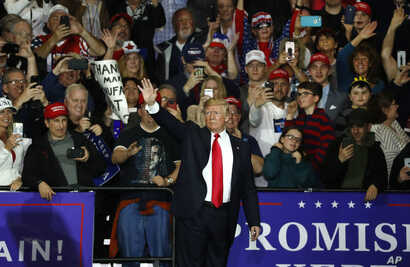 U.S. President Donald Trump waves after a campaign rally in Washington Township, Michigan, April 28, 2018.