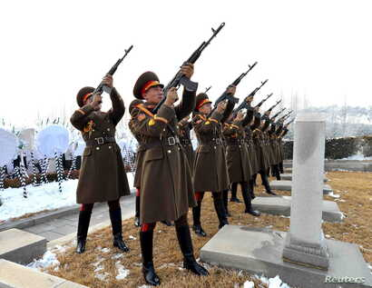 A gun salute is performed at the funeral of senior North Korean official Kim Yang Gon in Pyongyang in this photo released by North Korea's Korean Central News Agency (KCNA) on Dec. 31, 2015.