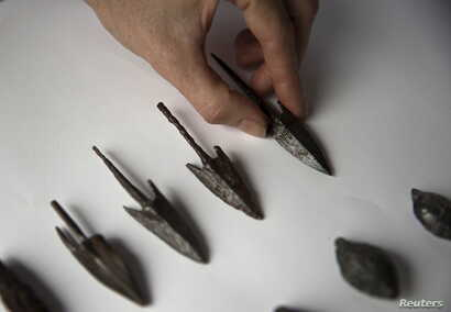 Arrowheads, uncovered by Israeli archaeologists at a site that they say contains the remnants of an ancient Greek fortress, are displayed in Jerusalem, Nov. 3, 2015.