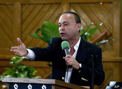 FILE - Rep. Luis Gutierrez, D-Ill., speaks to immigrant rights advocates during a rally against then President-elect Donald Trump's immigration policies at Metropolitan AME Church in Washington, Jan. 14, 2017.