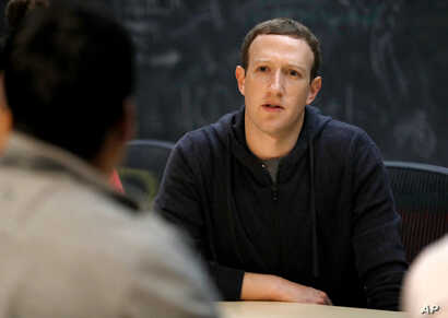 FILE - Facebook CEO Mark Zuckerberg meets with entrepreneurs and innovators during a round-table discussion in St. Louis, Nov. 9, 2017.