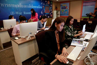 Government staff work as they monitor social media in a social media war room in Bangkok, Thailand, March 8, 2019.