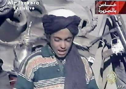 FILE - Hamza bin Laden, son of al-Qaida founder Osama bin Laden, is shown in this frame grab taken from the Al Jazeera news channel, Nov. 7, 2001. Hamza bin Laden has been trying to ease tensions with Islamic State in an effort to encourage the merge...