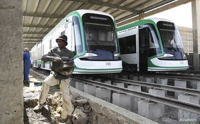 A worker works on the electrified light rail transit construction site in Ethiopia's capital Addis Ababa, Dec. 16, 2014. The project, built by China Railway Engineering Corporation (CREC) and mostly financed through a loan from China's Exim Bank, is ...