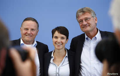 FILE - (L-R) Berlin top candidate of the anti-immigration party Alternative for Germany (AfD) Georg Pazderski, AfD Germany co-leaders Frauke Petri and Joerg Meuthen pose after a news conference in Berlin, Sept. 19, 2016.