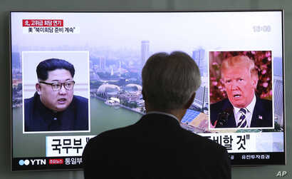 A man watches a TV screen showing file footage of U.S. President Donald Trump, right, and North Korean leader Kim Jong Un during a news program at the Seoul Railway Station in Seoul, South Korea, May 16, 2018.