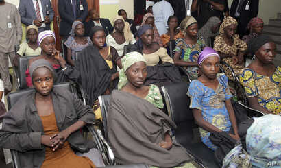 FILE -  Chibok school girls, recently freed from Boko Haram captivity, are seen during a meeting with a government official in Abuja, Nigeria on Oct. 13, 2016.