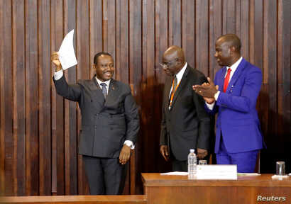 Guillaume Soro holds a document after being re-elected as the president of the National Assembly in Abidjan, Ivory Coast, Jan. 9, 2017.