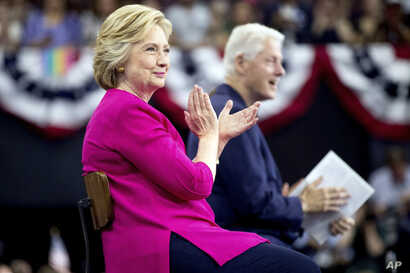 Democratic presidential candidate Hillary Clinton and former President Bill Clinton arrive for a rally at McGonigle Hall at Temple University in Philadelphia, July 29, 2016. (AP)