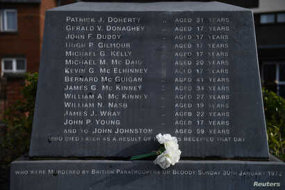 Flowers are left at the memorial for the people who died during the Bloody Sunday events, in Londonderry, Northern Ireland, March 14, 2019.