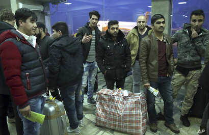 Afghanistan Germany MigrantsAfghans who were deported from Germany arrive at Kabul International Airport, Kabul, Afghanistan, Dec. 15, 2016. A Kabul airport official says 34 Afghan former asylum seekers returned home after being deported from Germany...
