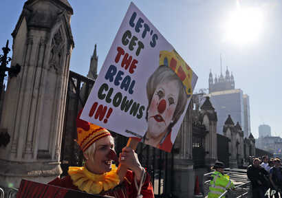 A Demonstrator protests at the entrance of the Houses of Parliament in London, Feb. 26, 2019.