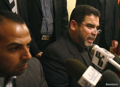 FILE - Hamas official Salah al-Bardawil, right, talks during a news conference in Cairo, Jan. 14, 2009.
