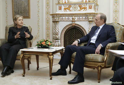 FILE - U.S. Secretary of State Hilary Clinton, left, and Russian Prime Minister Vladimir Putin meet at the presidential residence Novo-Ogaryovo outside Moscow, March 19, 2010.